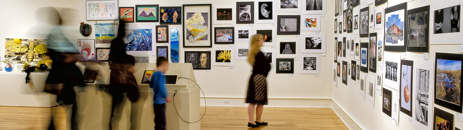 Patrons browse the 2019 Scholastic Art and Writing displays at the Fort Wayne Museum of Art. <span class=&apos;image-credits&apos;>By Ray Steup</span>