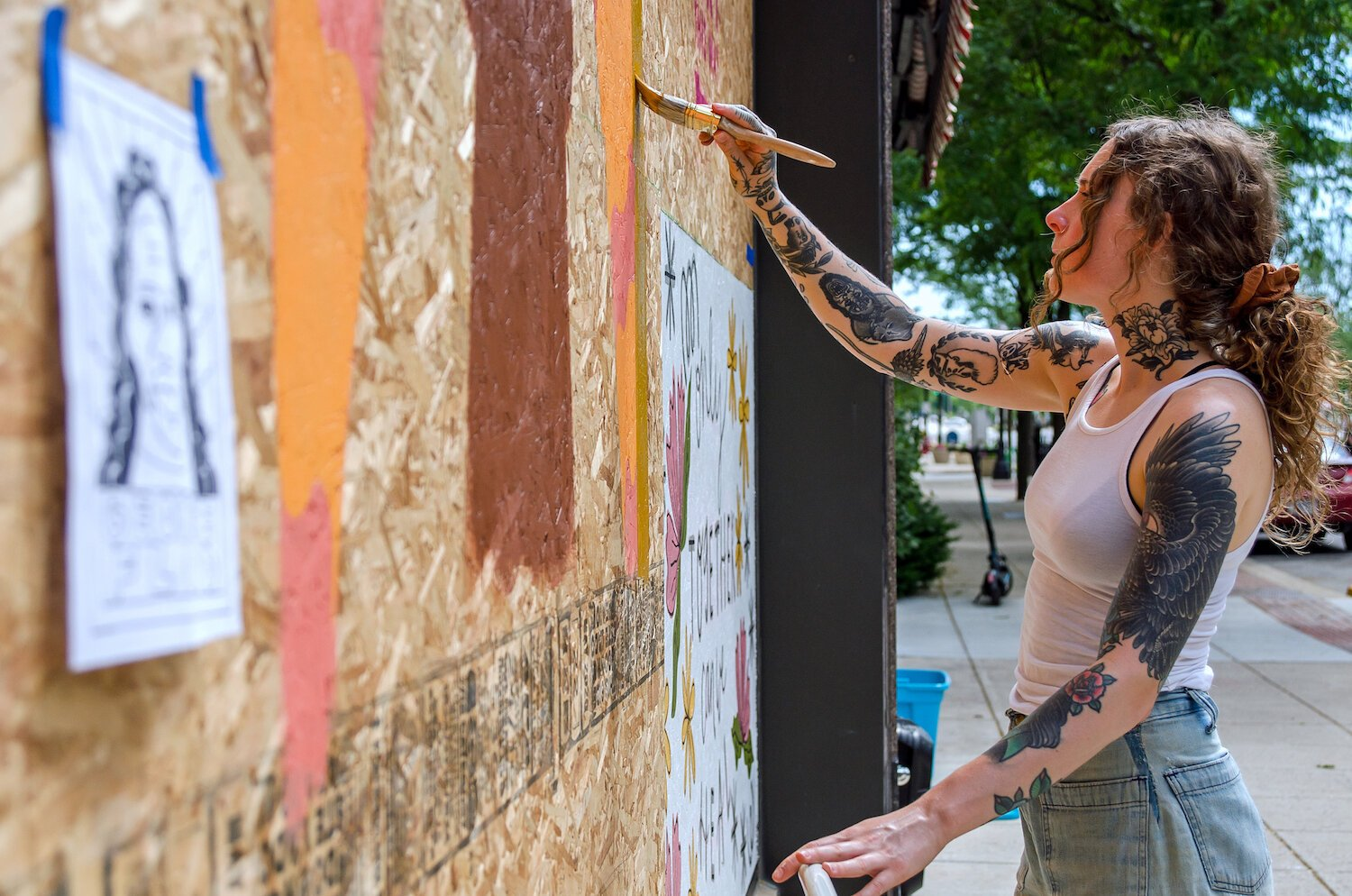 Adeline Griswold paints a mural in downtown Fort Wayne.