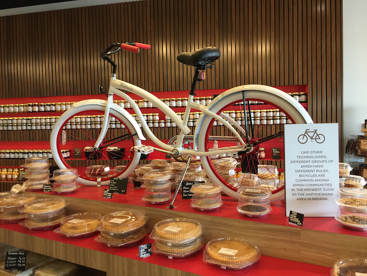 Displays at Rise 'n Roll Bakery teach customers about aspects of Amish culture, like biking.