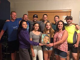 Drew Shipley, center, surrounded by his family and friends who created the Andrew Shipley Memorial Ride.