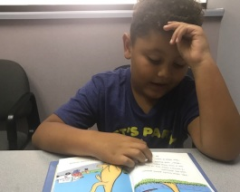 Breydon practices reading at the Fort Wayne Center for Learning.