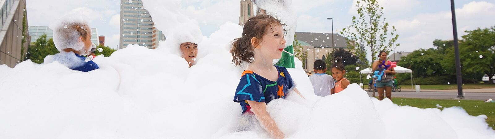 Children play in bubbles during Open Streets in downtown Fort Wayne. <span class='image-credits'>By Stephen J. Bailey</span>