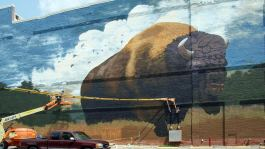 Tim Parsley paints a bison mural on the Landing in downtown Fort Wayne.