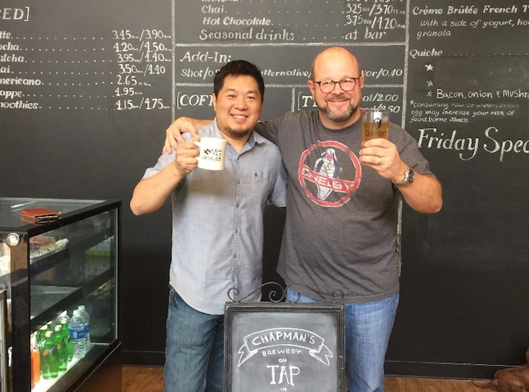 Sean Wang, left, and Scott Fergusson, right, celebrate the Chapman's tap room in downtown Fort Wayne at Fortezza Coffee.