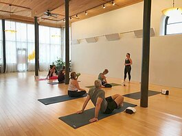 Co-Owner Sarah Evans leads a class at Baptiste Power Yoga Fort Wayne.