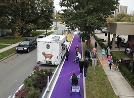 As part of the Better Block event, volunteers painted a temporary bike path on Columbia Avenue.