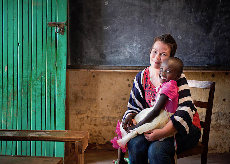 Denise DeMarchis, the late founder of Matilda Jane Clothing, holds Nancy, a child she sponsors in Kenya.