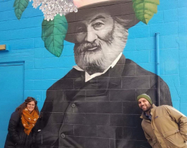 Amanda Golden and Josh Lapp of Designing Local pose in front of Tim Parsley's Walt Whitman mural in downtown Fort Wayne.