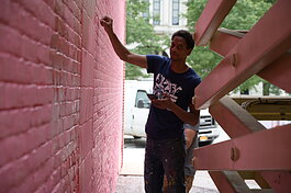 Shawn Dunwoody works on a mural in downtown Columbia City.