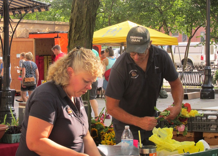 """Farmer Dan"" Flotow and his wife, Wendy, have a booth at the YLNI Farmers Market in Fort Wayne."