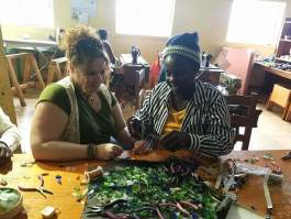 CWOW's Vanessa Sheckler, left, assists a Haitian artist with product development.
