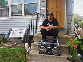 Francisco Reyes sits outside his house in Southeast Fort Wayne where he's building a culture around Hip-Hop.