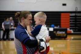 Lisa Czechowski, a member of the qualifying USA women's goalball team, celebrates with her son.