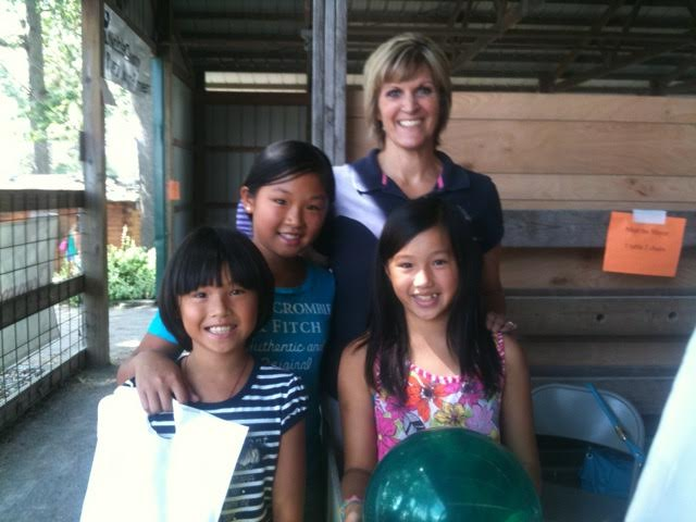 Mayor SuzAnne Handshoe, right, with students from one of her Junior Achievement classes.