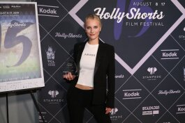 Hart poses with her award at the HollyShorts Film Festival 2019.