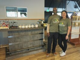 Dave Thomas, left, the owner of Health Hut poses with sales associate, Elizabeth Moreno.