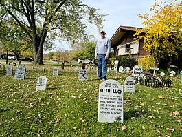 Kevin Morse's yard in the 3700 block of Chancellor Dr. features a Halloween display with 352 handmade tombstones.
