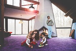 The Jackson family did a fun 70s-themed photoshoot with Fort Wayne photographer Dustin McKibben as a tribute to the home's retro design.