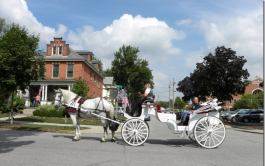 Complimentary horse-drawn carriage rides are part of the Home and Garden Tour experience.