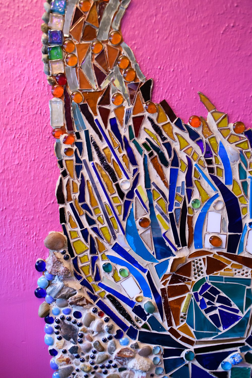 Colorful mosaic work on the Porter family fireplace.