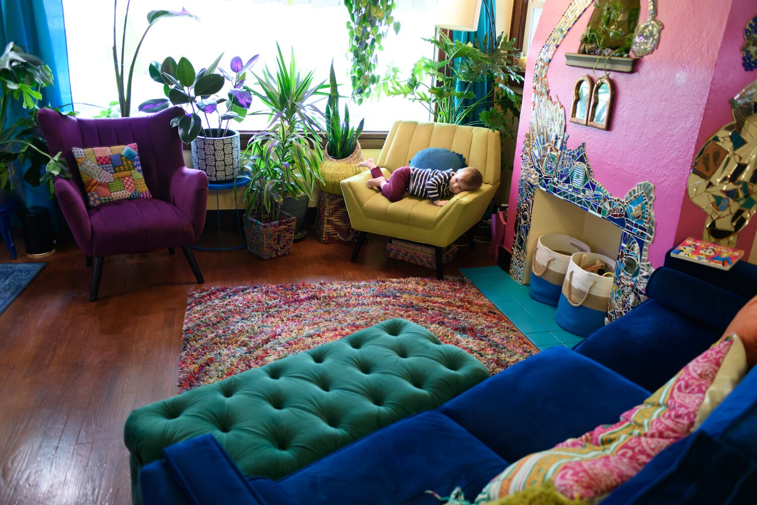 The living room is filled with lots of color and plants.