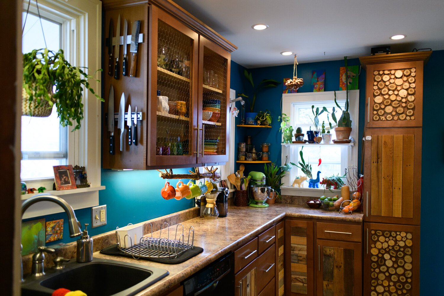 The kitchen features a lot of plants and woodwork at the Porter family home.