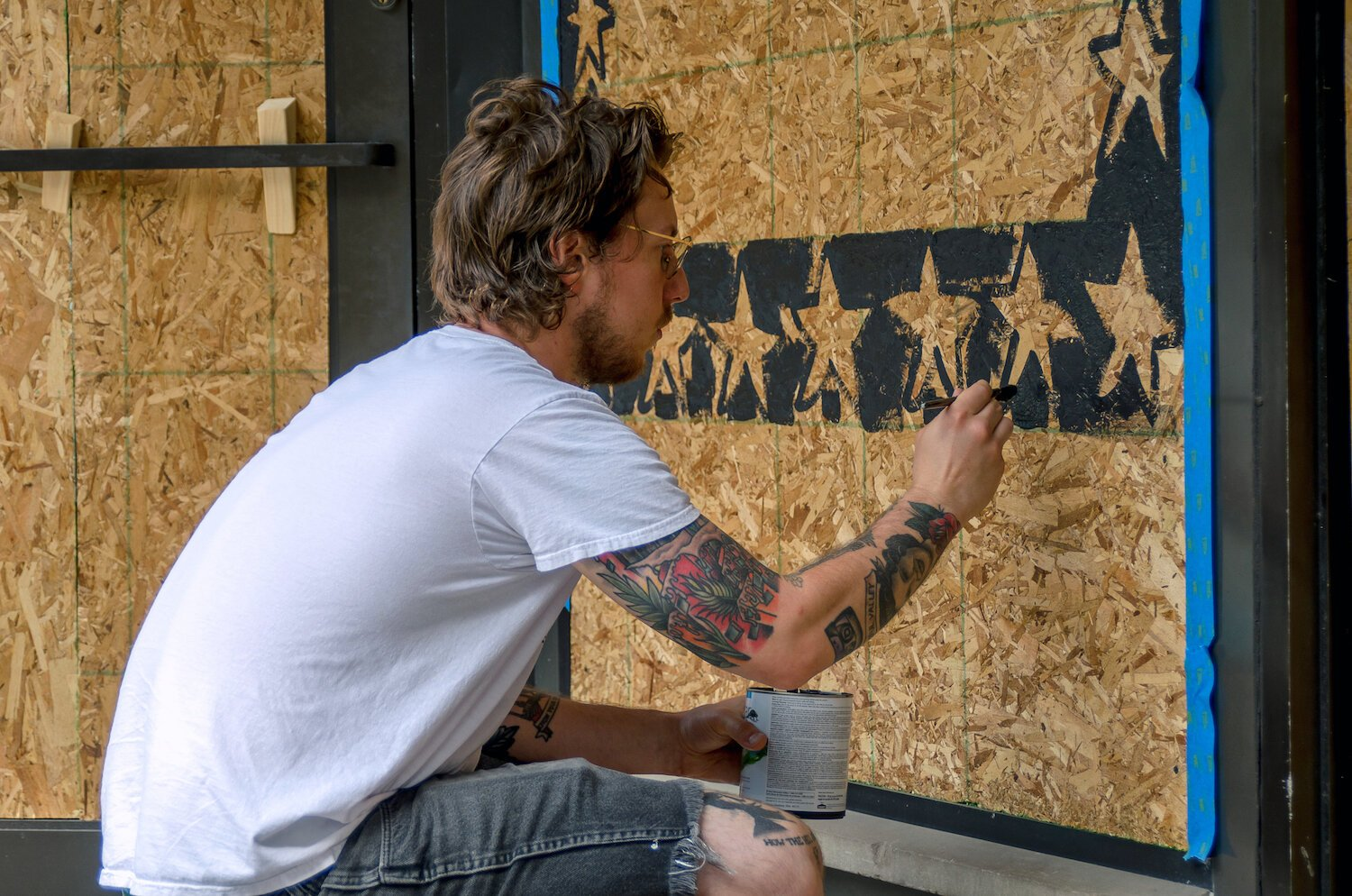 Jared Andrews paints a mural in downtown Fort Wayne.