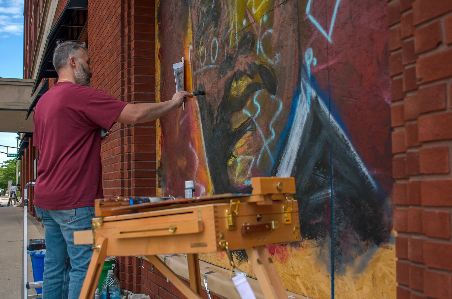 Jeff Pilkinton paints a mural of Mt. Luther King Jr. in downtown Fort Wayne.