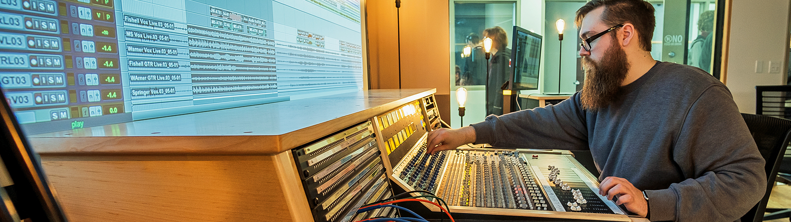 Josiah Hawkins, a senior in the Purdue Fort Wayne Music Technology Program, operates a sound board in Control Room of the Purdue Fort Wayne Sweetwater Music Center. <span class=&apos;image-credits&apos;>By Ray Steup</span>