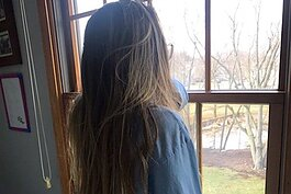 Lauren Wong looks out her window in Chicago after her college closed for COVID-19.
