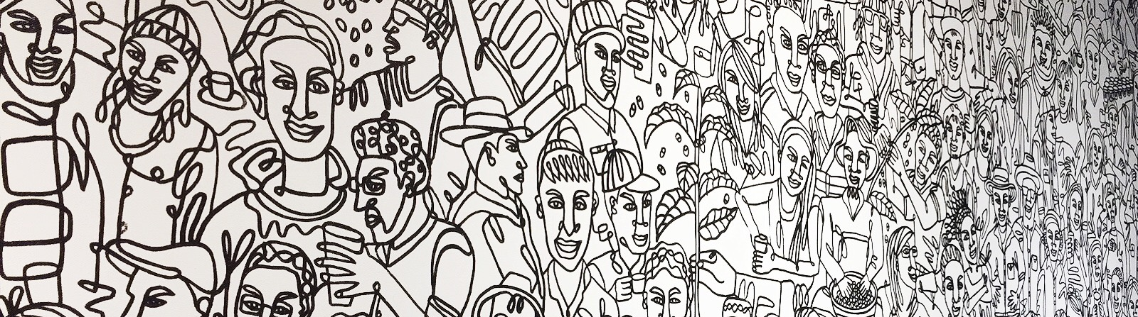 A mural of people around the world inside the Hilton Fort Wayne Starbucks at 1020 S. Calhoun St. <span class='image-credits'>By Kara Hackett</span>