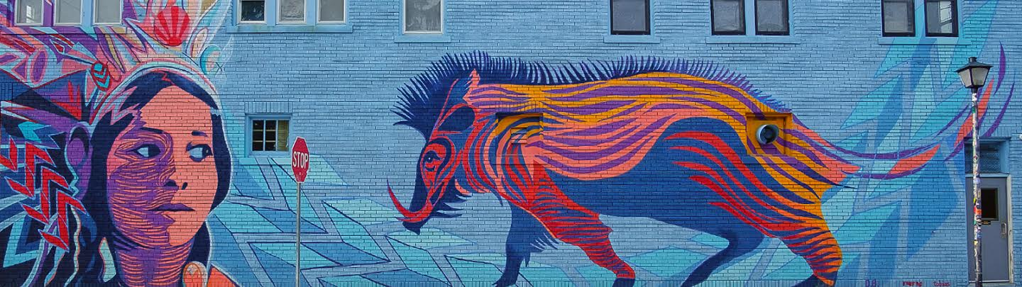 A mural on the Brass Rail in downtown Fort Wayne honors Native American history in northeast Indiana. <span class='image-credits'>By Ray Steup</span>