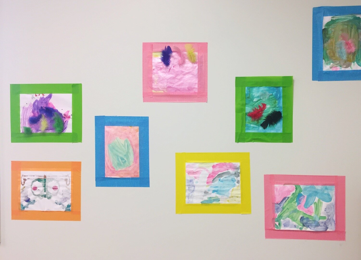 Artwork made by children at the Shaw Center decorates the walls.