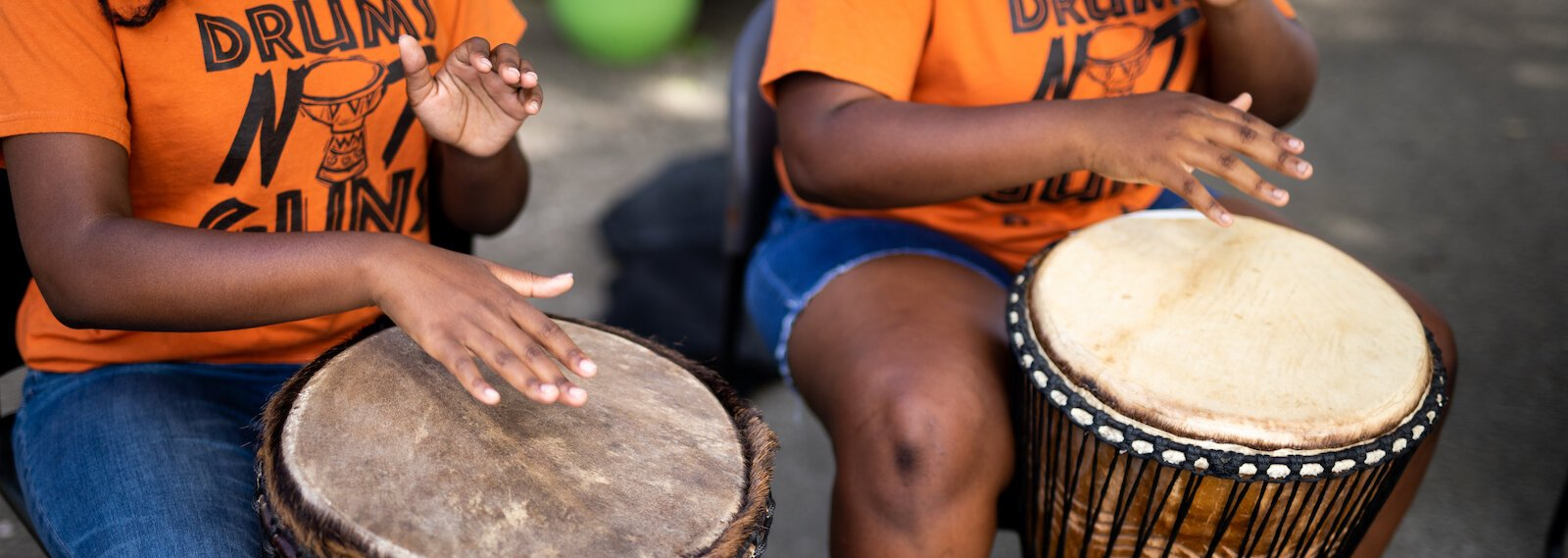 "Members of the Omotayo Rite of Passage ""Drums Not Guns"" program perform a song in Southeast Fort Wayne."