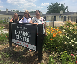 Tiffany Brewer, Karen Birsfield, and Melonie Bradtmueller stand in front of what will be the future leasing center at Parkview Village.