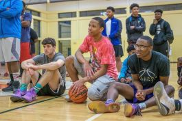 Participants of the Fort Wayne United Late Night Basketball Program prepare to play.
