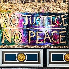 Alyssum Montessori School transformed its broken windows into murals supporting a nonviolent protest.