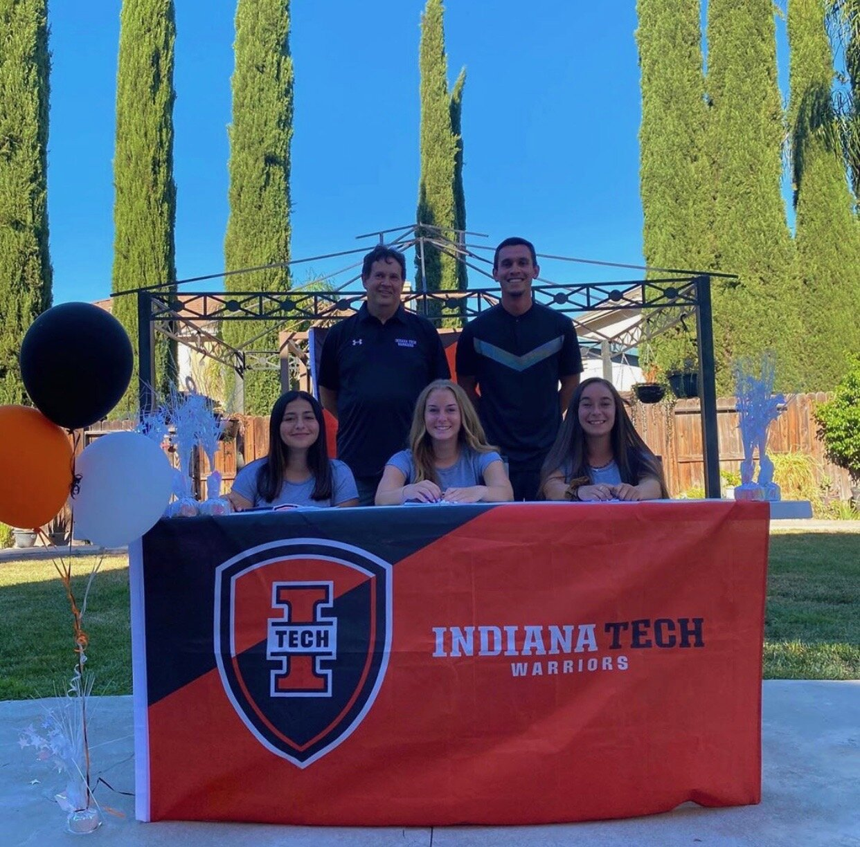 From left, back row are Indiana Tech Women's Soccer Coaches Jim Lipocky and Glen Gomez. In front of them are players Karmina Jimenez, Alyssa Williams, Alina Garcia.