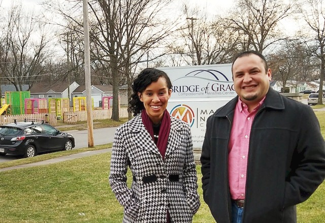 Réna Bradley and Pastor Javier Mondragon stand in front of a playground designed by local students working with Bridge of Grace.