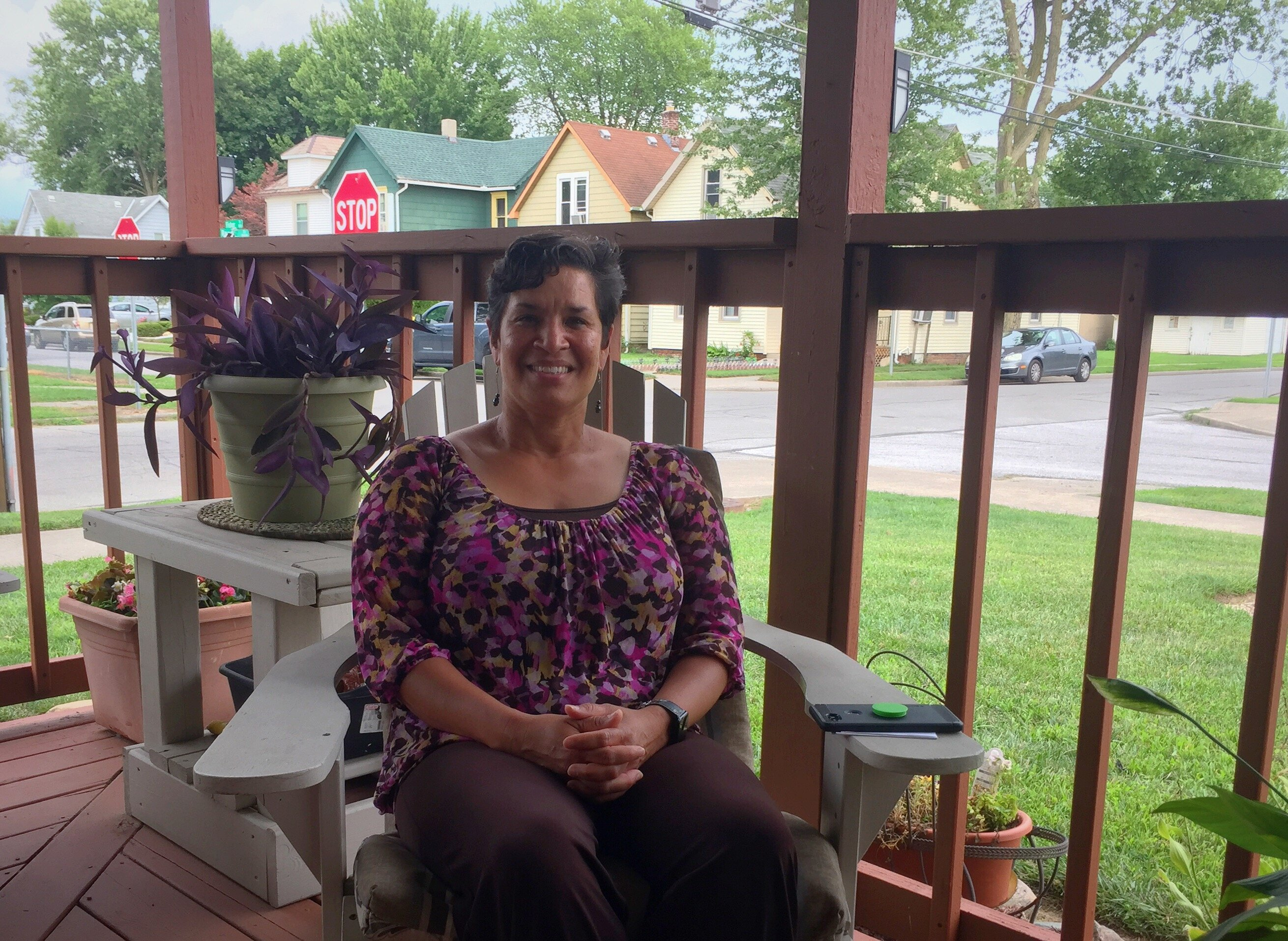 Rebecca Ridley enjoys her front porch in the Renaissance Pointe neighborhood.