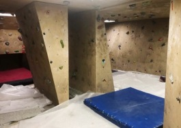 The rock climbing gym at Earth Adventures helps people train for outdoor excursions.