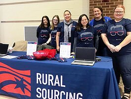 Colleagues at Rural Sourcing Inc.'s Fort Wayne Development Center support local tech talent initiatives like the Girl Scouts STEM Conference.