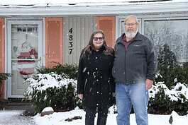 Joanne and Scott Randolph stand outside their Fort Wayne home, which once belonged to actress from The Office, Jenna Fischer.