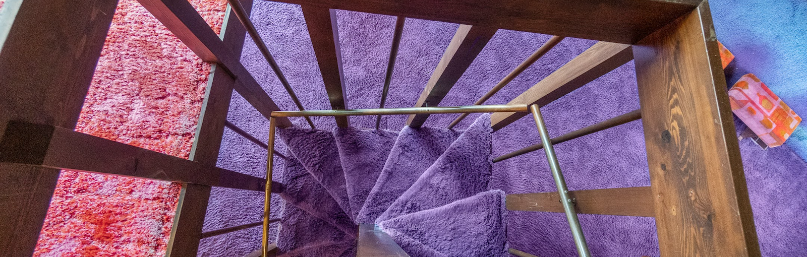 The psychedelic staircase of a viral 1970s time capsule home in Fort Wayne that's going from shag to chic.