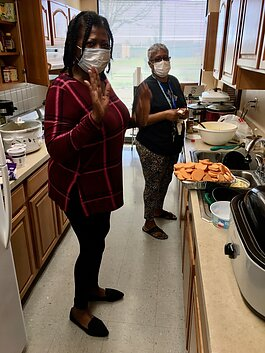 Tenant leaders at Tall Oaks Apartments give back to their fellow residents with home-cooked meals.