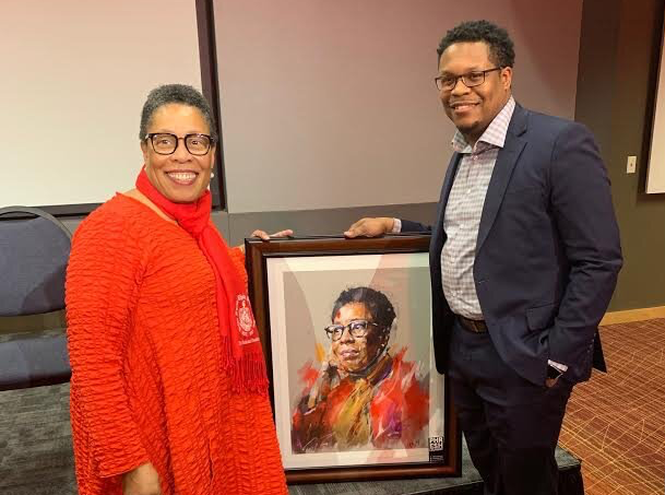 Fort Wayne artist Theoplis Smith III, the owner of Phresh Laundry, right, poses with Ohio Congresswoman Marcia Fudge.