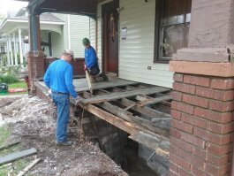 A volunteer crew with NeighborLink helped rebuild Kathleen Caudill's porch to meet city code.